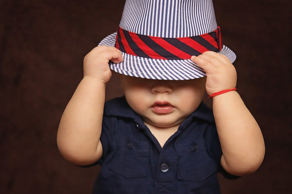 Cute kid in stylish hat. Vertical blue stripes. horizontal Red and black diagonal striped strap and buckle. Fashion statement Who's got swag Swagbucks 101. Passive income with autopilot Make money while sleeping rewards for a lifetime. Tutorial Review.