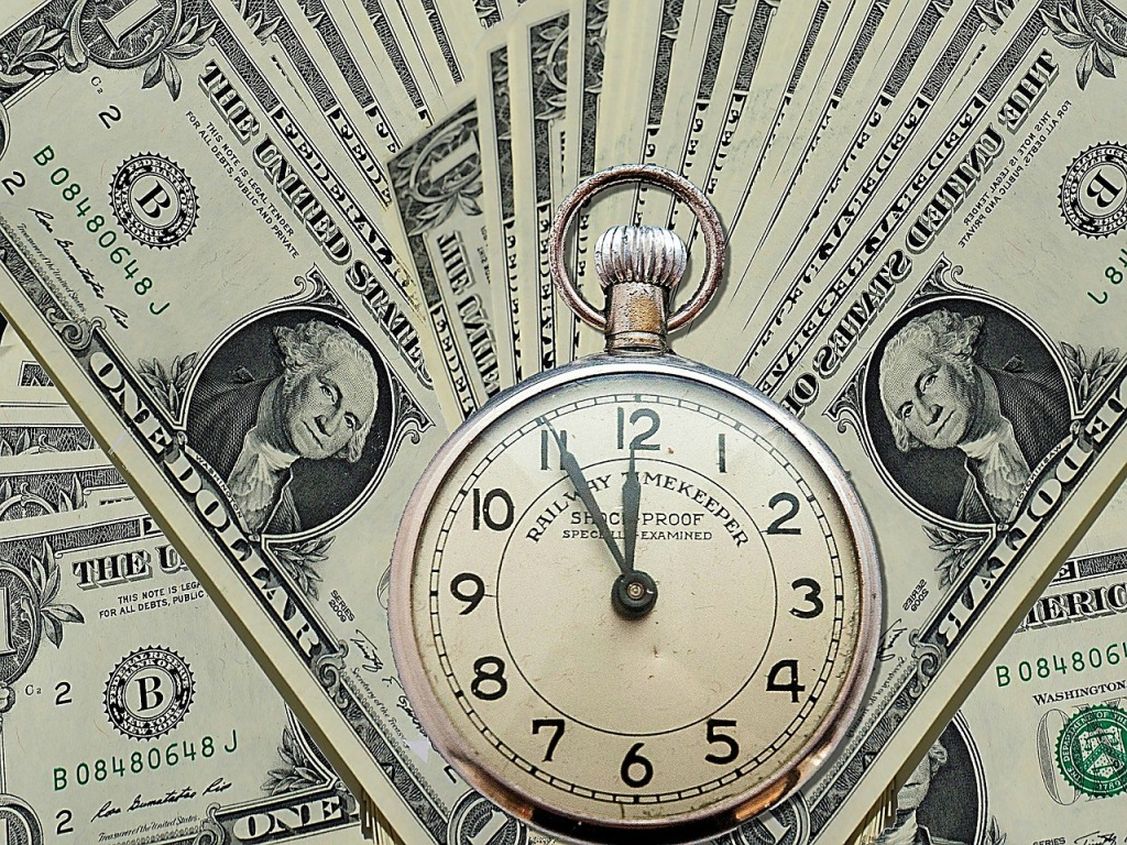 Reward code will soon expire! Analog silver clock with dollar bills spread out in background like a poker card game for viewing. Railway Mekeeper Schockproof Specially examined Timekeeper