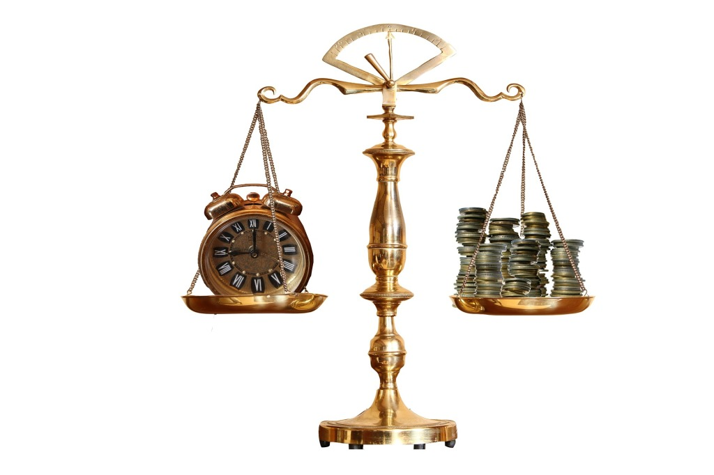 Gold money scale with clock and coin finance and financial weight comparison tool.